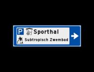 Verwijsbord KOKER Blauw/wit/zwart - pijl rechts, 2 regelig met 3 pictogrammen - Klasse 3 reflecterend